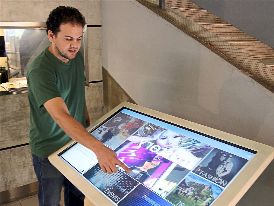 Citylab Studio programme director Syed Iskandar showing the Digital Navigator, which is an electronic directory board installed by Citylab Studio.