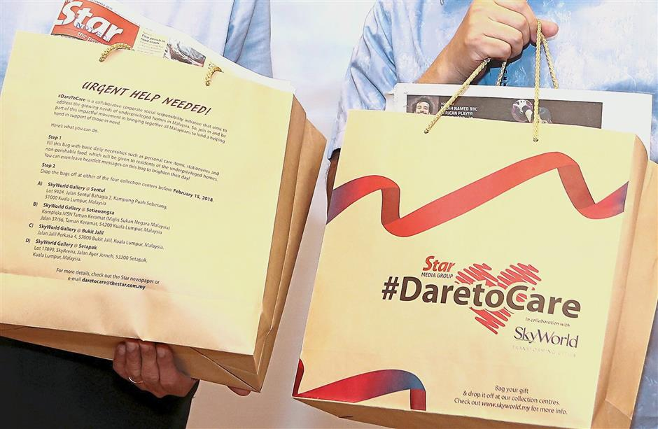 The paper bags can be filled with gifts or donations of essential items such as personal care goods, stationery and non-perishable food products.