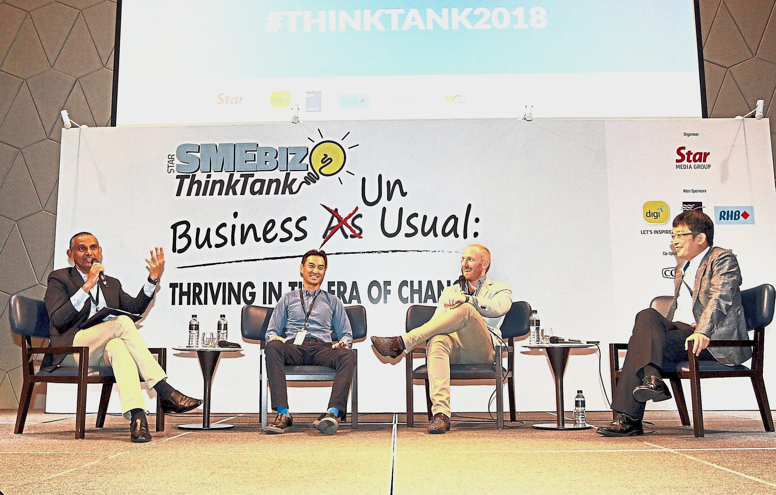 Malaysian Associated Indian Chambers of Commerce and Industry secretary-general Datuk Dr A.T. Kumararajah (left) moderating a discussion with (from second left) Aemulus chief executive officer  Ng Sang Beng, Supahands sales vice-president Greg Meehan and Digi chief business officer Eugene Teh during the Star SMEBiz ThinkTank 2018 at New World Petaling Jaya Hotel. u2014 Photos: SAMUEL ONG and AZMAN GHANI/ The Star