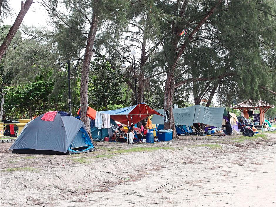 Closer to nature: Tents lining up the beach as campers enjoy roughing it out on the beach.