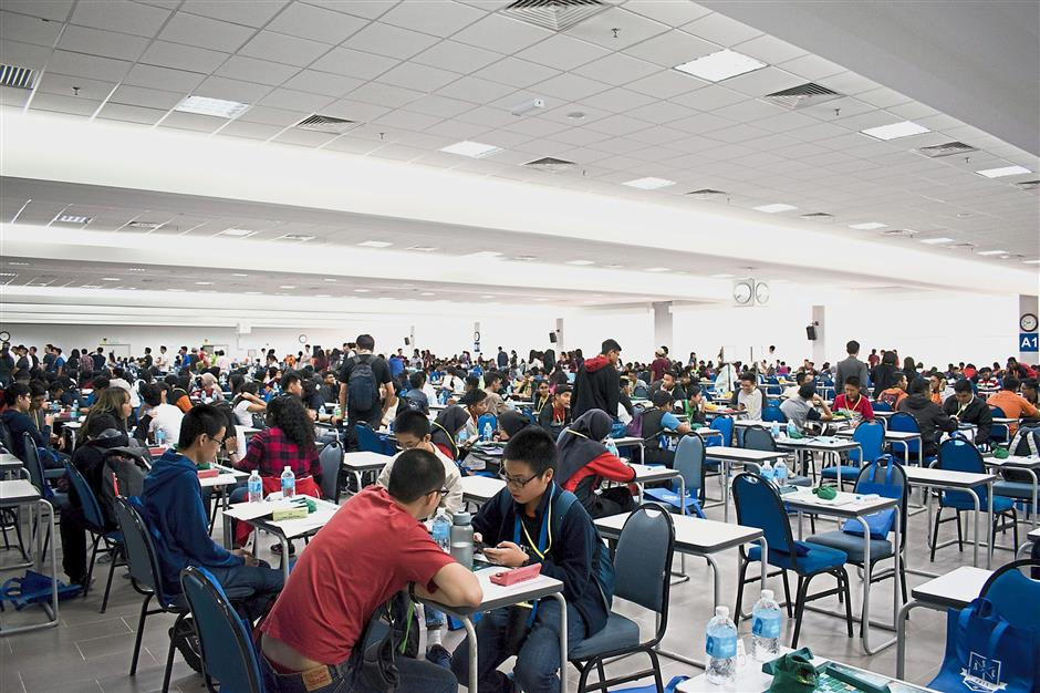 ASCI participants deep in concentration at the tournament venue in Universiti Malaya.