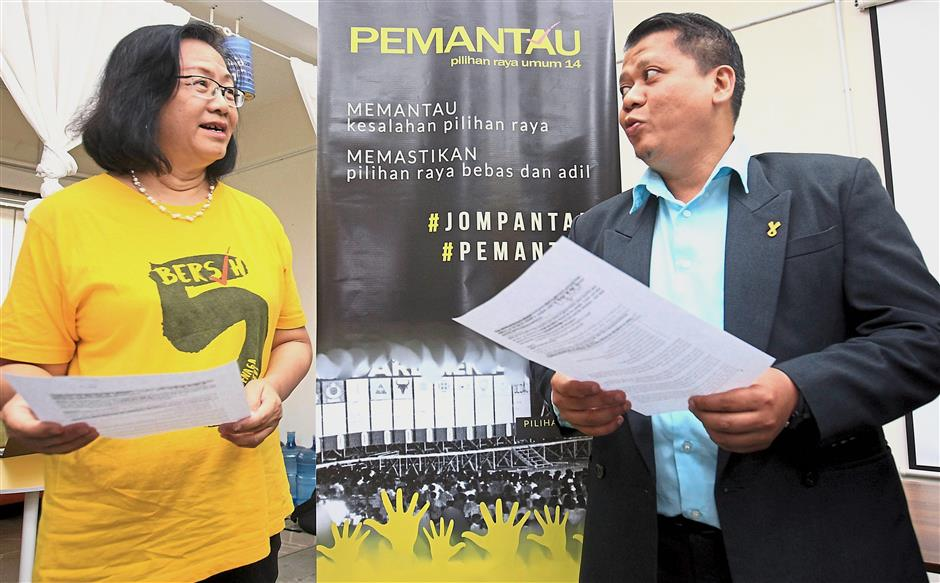 Asking for change: Maria and her deputy Shahrul Aman Mohd Saari holding a press statement at the Bersih office in Petaling Jaya.