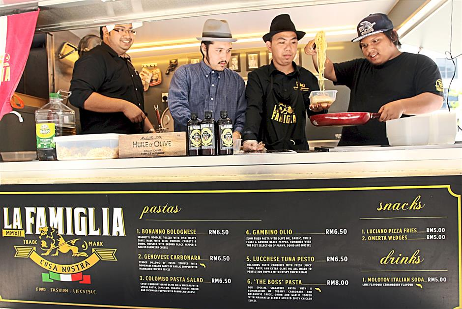 The men of behind the La Famiglia food truck, (from left) Rusydi, Syazawan, Danial and Syafiaq.
