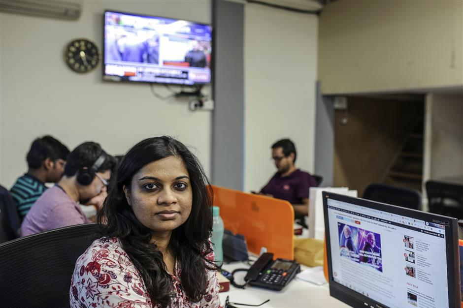 Karen Rebelo, deputy editorof Boom Live, poses for a photograph at the company's offices in Mumbai, India, on Friday, March 28, 2019. Boom is one of seven tiny fact-checking firms at the heart of Facebook Inc.'s efforts to rebuild some of its credibility during India's elections. Photographer: Dhiraj Singh/Bloomberg