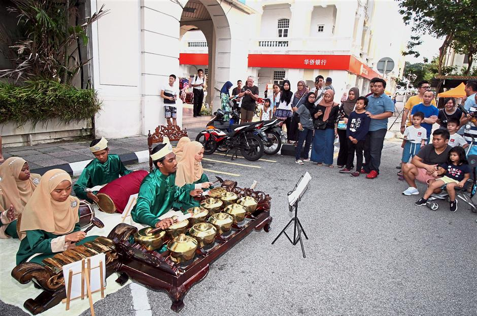 Visitors watching the gamelan performance during the Sama-Sama Ria Cultural Street Fest in Ipoh. — Photos: SAIFUL BAHRI/The Star