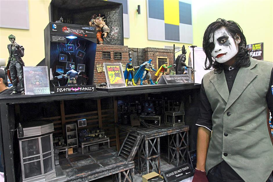 Big fan: Ziman, dressed as the Joker, says he became a Batman fan after his father introduced him to the character.