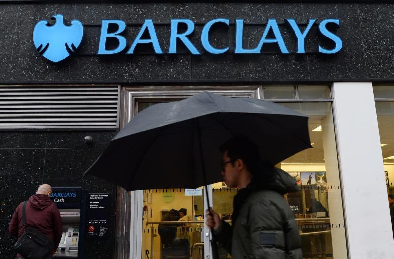 A pedestrian walks past a Barclays bank branch in London in Britain, Feb 11, 2014. UK Banks including Barclays, UBS AG, Royal Bank of Scotland and Rabobank have paid out billions in fines, and agreed to turn over all information that the US Department of Justice requested - EPA Photo.