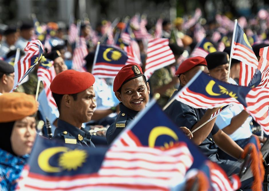 Practice makes perfect: Members of uniformed units waving the Jalur Gemilang during a rehearsal for the National Day celebration at Dataran Putrajaya. A total of 15,000 contingents will be taking part in this year's celebration, which carries the theme 'Sayangi Malaysiaku'. — Bernama
