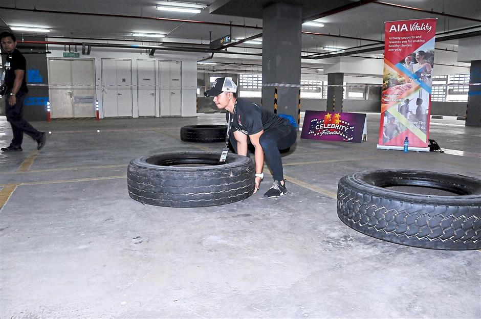 (Right) These giant tyres look docile but are tough to flip over.