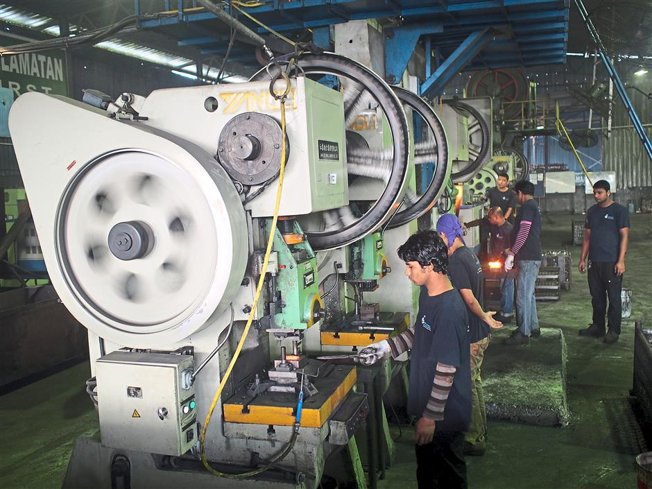 Man & machine: Factory operators hard at work in manufacturing one of the coupler designs.