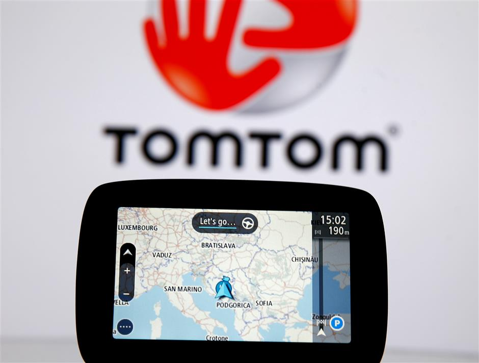 FILE PHOTO: TomTom navigation are seen in front of TomTom displayed logo in this illustration taken July 28, 2017. REUTERS/Dado Ruvic/File Photo
