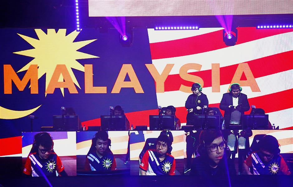 Malaysian League of Legends players in action at Hyperplay, an e-sports tournament held in Singapore, Aug 4, 2018. — Reuters