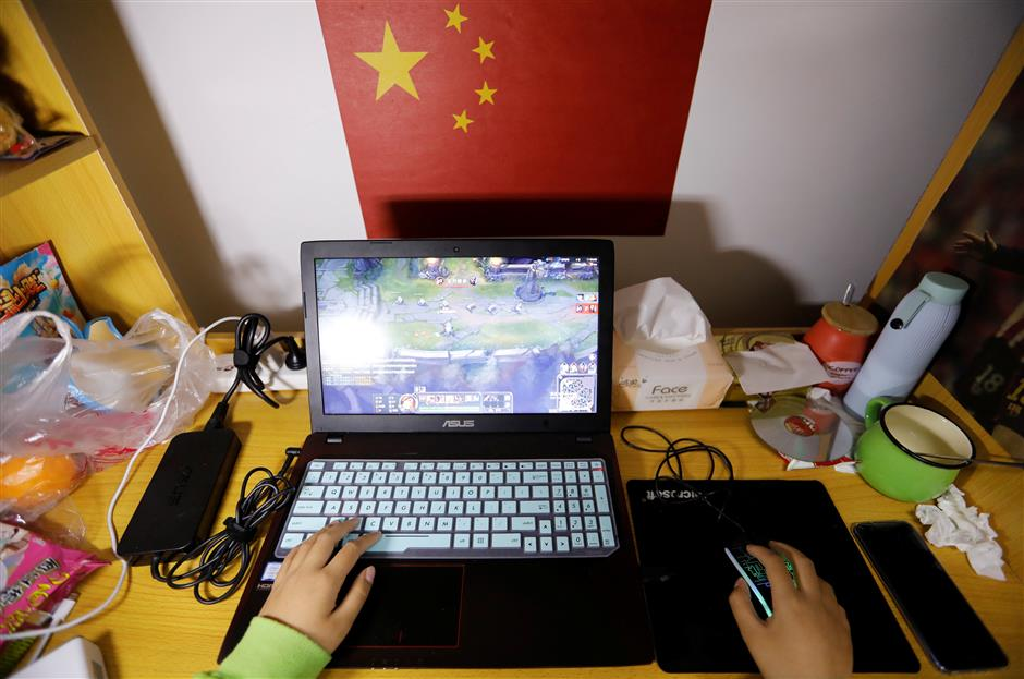 A student majoring esports and management practices on her laptop in a dormitory at the Sichuan Film and Television University in Chengdu, Sichuan province, China, November 19, 2017. The curriculum of the course is designed to prepare students for jobs in the growing industry that supports professional esports players who reach the peek of their career in their teenage years. The students study a wide range of subjects from commentating and script writing to event organising and gaming strategy. Picture taken November 19, 2017. REUTERS/Tyrone Siu