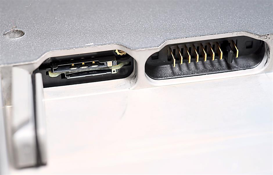 Hidden ports: underneath the removable battery for the Panasonic Toughpad FZ-M1is a SIM and microSDXC slot combo on the left. The right side has the connectors for the battery, which are also weather sealed.