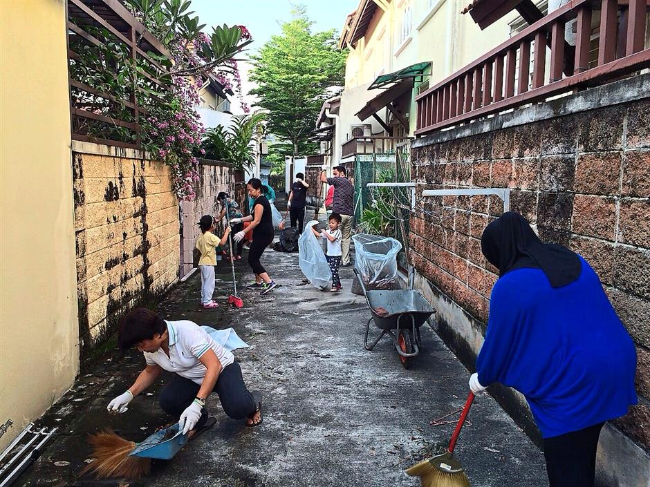 Sweep away: Residents sprucing up a back lane in Adonis Blue Bukit Jelutong during a gotong-royong session to keep the neighbourhood clean.