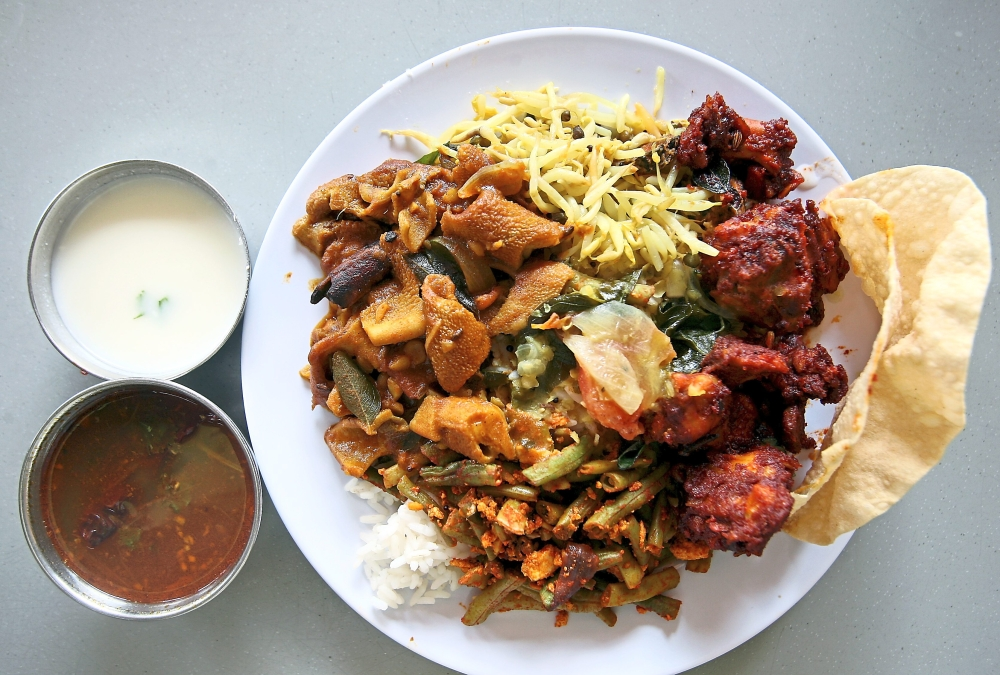 Lotus Curry House has chicken varuval that is only mildly spicy as well as kodal curry (goat tripe).