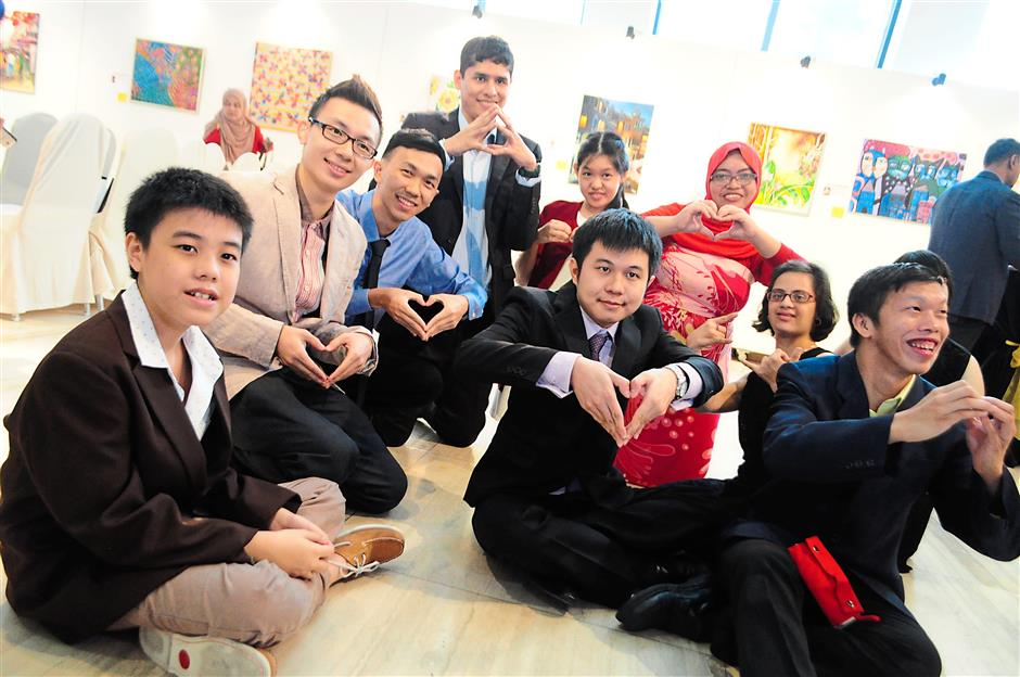 1 The artists (from left) Jeremy Khor, Leong Keng Hoong, Edward Wong, Yuri, Tam (back), Clement Ooi (in front of Tam), Izzati, Sarah and Chen Wei Lum.