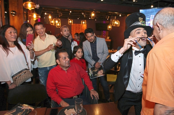 The magician entertaining guests with his tricks during the award presentation.