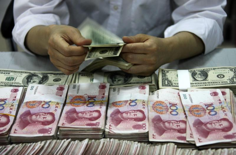 China\'s foreign direct investment (FDI), which excludes financial sectors, totalled US$117.59bil last year, the commerce ministry says - AFP Photo.