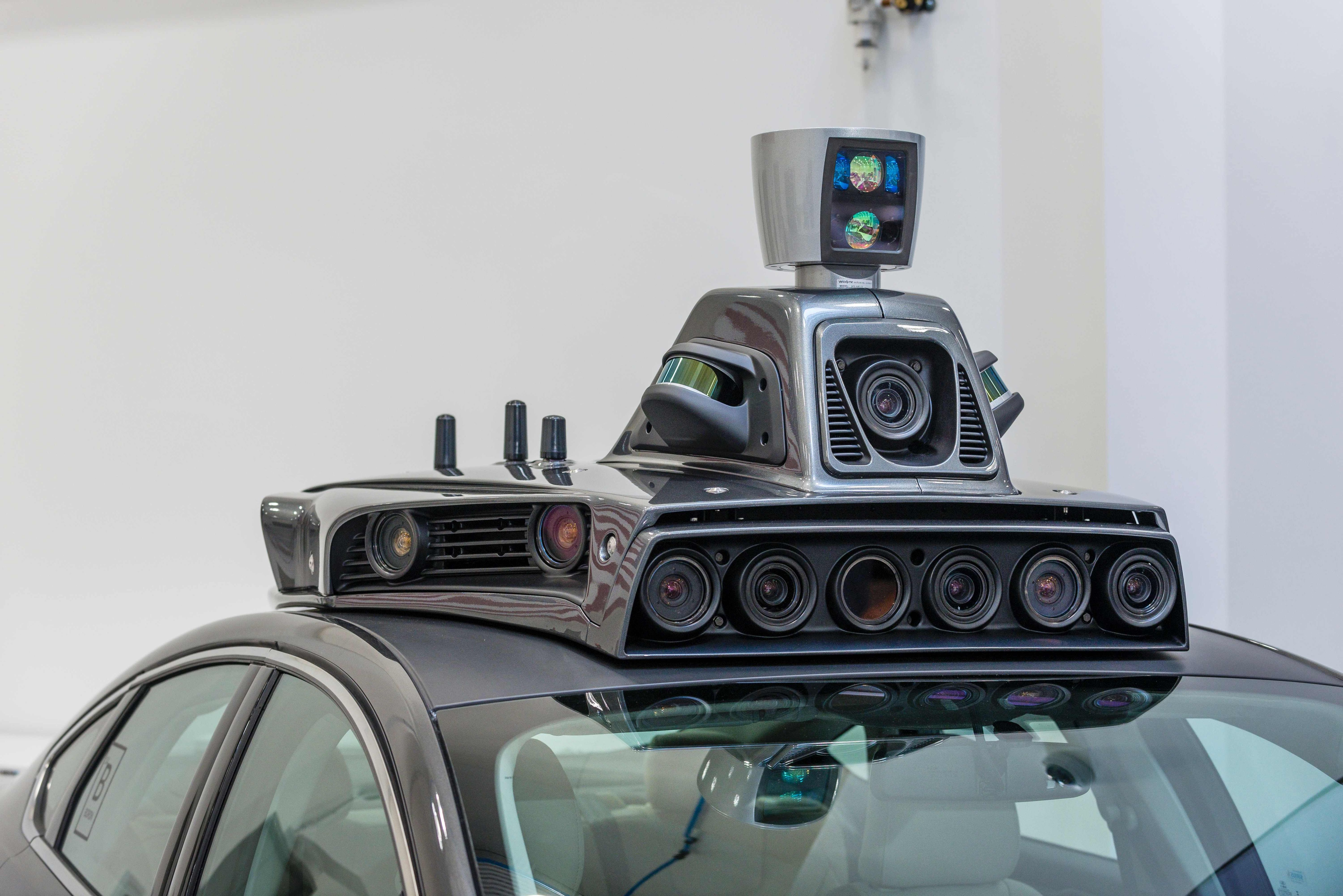 FILES) This file photo taken on September 13, 2016 shows the cameras on a pilot model of an Uber self-driving car at the Uber Advanced Technologies Center in Pittsburgh, Pennsylvania. Uber has grounded its fleet of self-driving cars pending an investigation into the crash of an Uber autonomous vehicle in Arizona, a spokesperson for the car-hailing service said on March26, 2017. No one was seriously injured in the accident which occurred on March 24 in Tempe, Arizona, while the vehicle -- a Volvo SUV -- was in self-driving mode, the company said. / AFP PHOTO / Angelo Merendino
