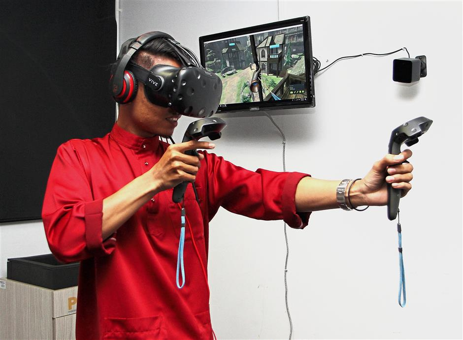 A library staff demonstrating a VR archery game.