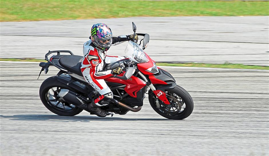Kiki taking her Ducati Diavel for a spin on Ladies Track Day at the Sepang Circuit.