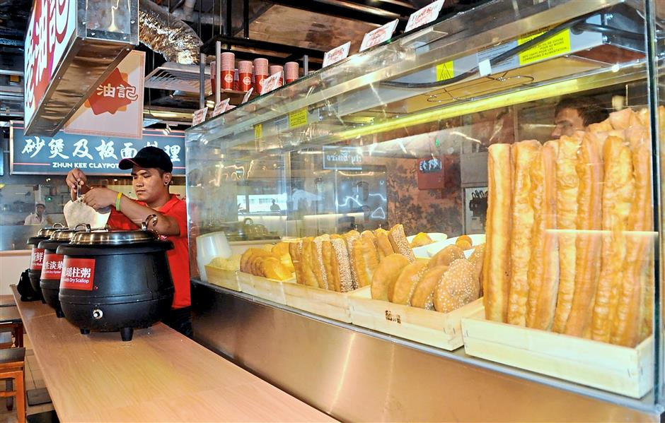 Yummy snack: A variety of traditional delicacies like you char kway (fried breadstick) and harm chim peng (deep fried bread with red beans filling) is available at the food court.