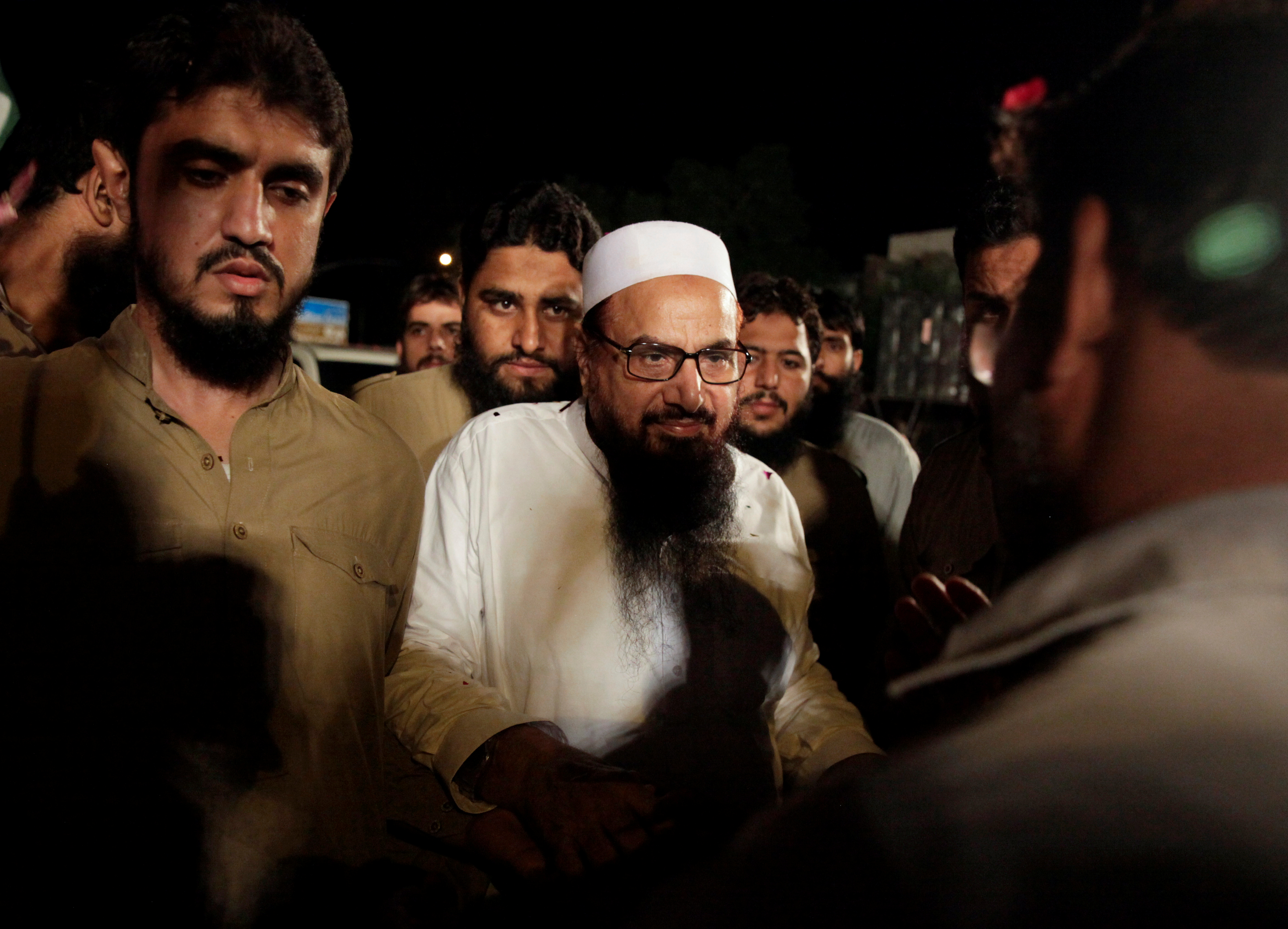 FILE PHOTO: Hafiz Muhammad Saeed, chief of the Islamic charity organisation Jamaat-ud-Dawa (JuD), arrives to attend a campaign rally of political party, Milli Muslim League (MML), ahead of general elections in Islamabad, Pakistan July 21, 2018. REUTERS/Faisal Mahmood