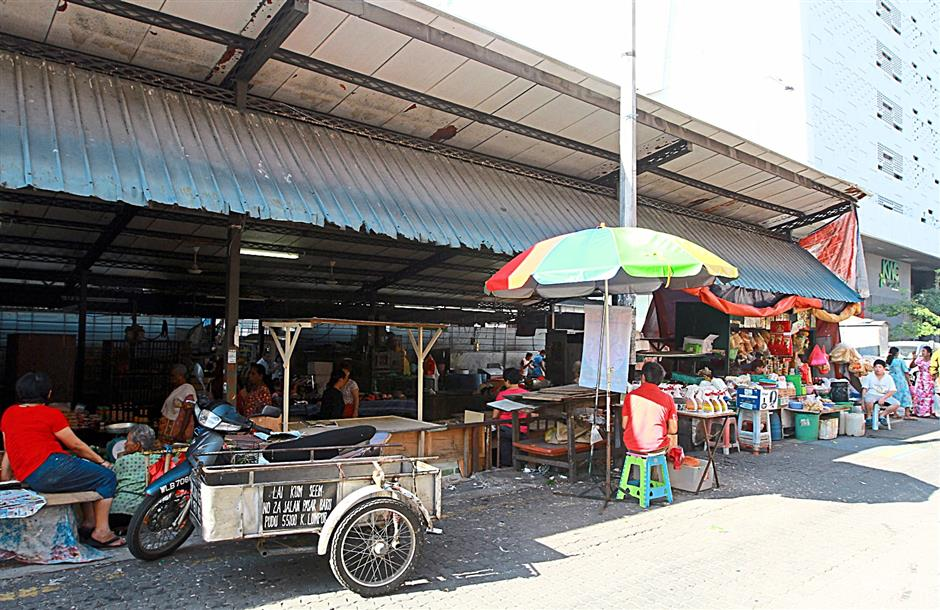 The morning market beside Kenanga Wholesale City will continue operating until a complex is built near the Pudu LRT station..  09 Sept 2014 CHAN TAK KONG/The Star