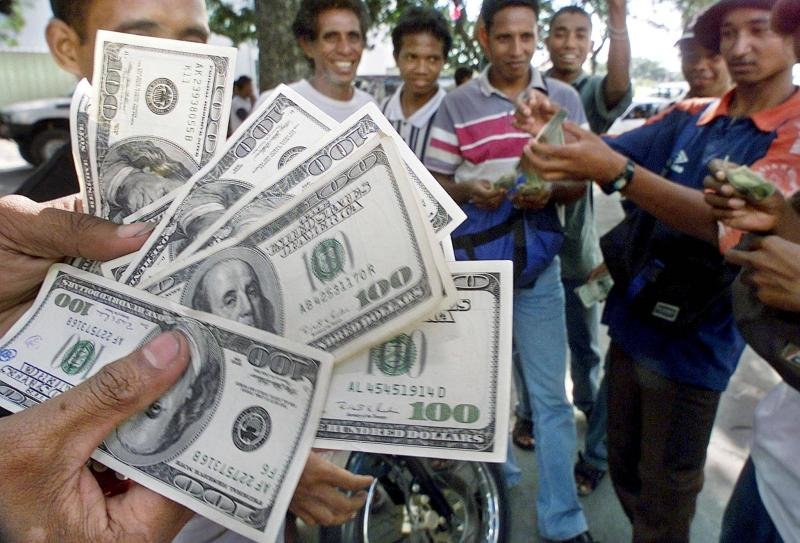 The US economy is now only about a fifth of the global whole but it produces the currency which accounts for something like 75% of global cross-border transactions - Reuters Photo.