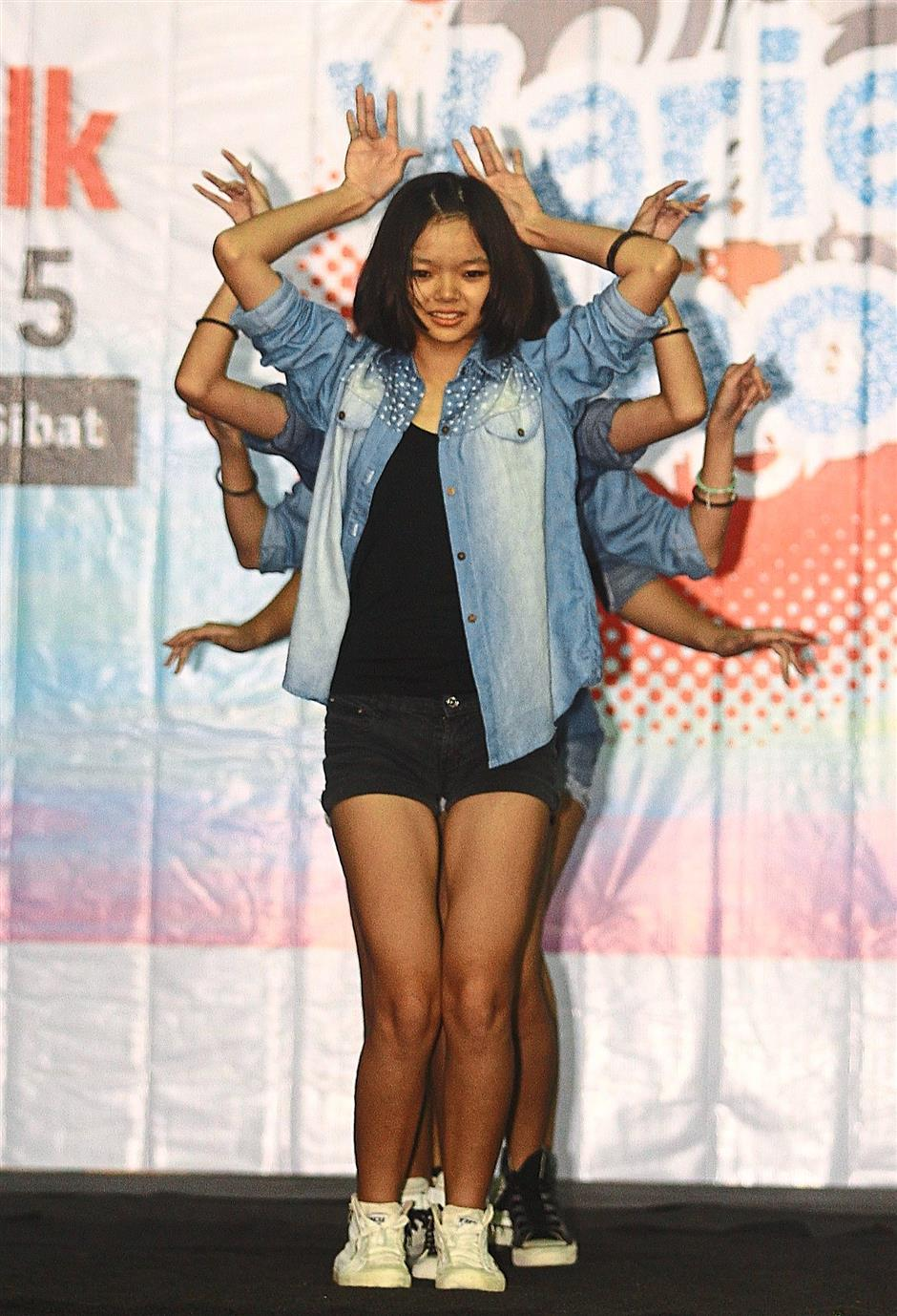 3 Dancers from D' Artiz Studio performing a hip-hop breakdance number at the variety show.