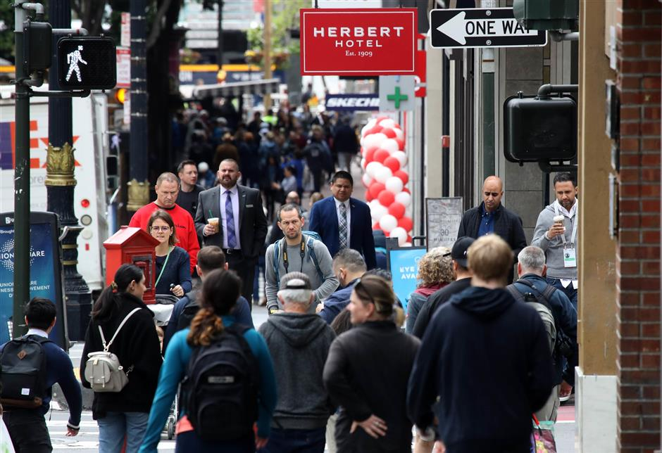 SAN FRANCISCO, CALIFORNIA - MAY 14: Pedestrians walk along Powell Street on May 14, 2019 in San Francisco, California. San Francisco could be the first city in the United States to ban facial recognition technology by police and city agencies. The San Francisco board of supervisors will vote on the measure today.   Justin Sullivan/Getty Images/AFP == FOR NEWSPAPERS, INTERNET, TELCOS & TELEVISION USE ONLY ==