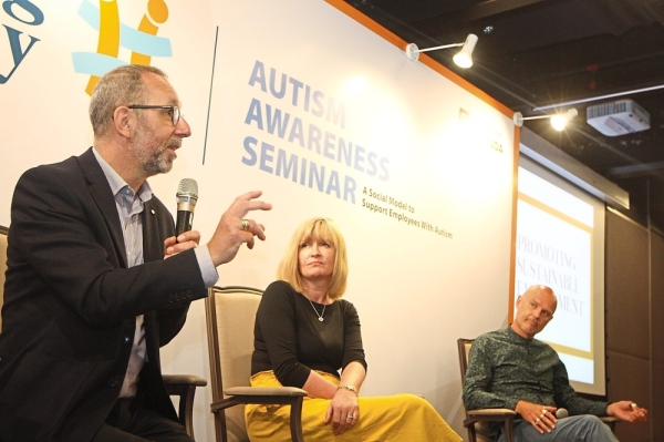 Keen interest: Bates answering questions from the floor during the Enabling Academy's Autism Awareness Seminar at Menara Gamuda in Petaling Jaya. With him are Runswick-Cole and Goodley. The University of Sheffield professors and researchers were in town to speak at the seminar.