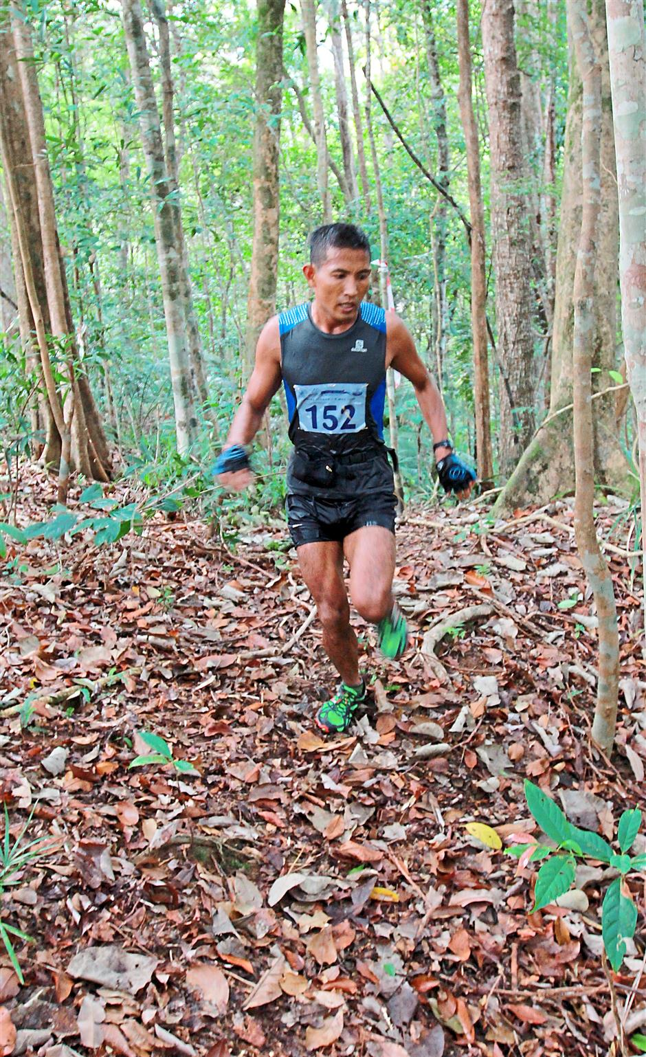 A runner in the midst of going through the jungle.