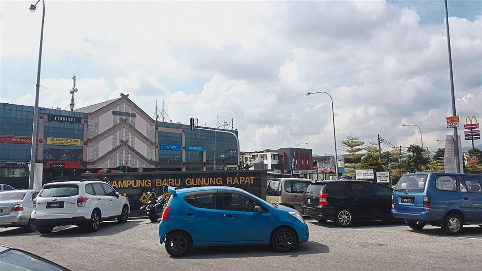 The main entrance to Kampung Baru Gunung Rapat, along Jalan Raja Dr Nazrin Shah in Ipoh, is a thriving commercial area these days.
