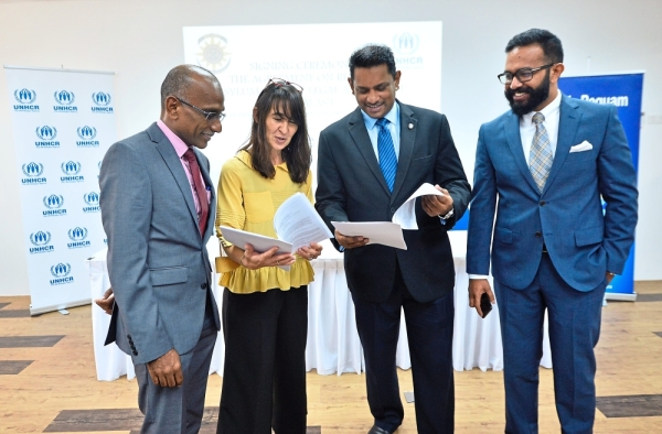 United Nations High Commissioner for Refugees (UNHCR) deputy representative (Protection) Maja Lazic (second from left) and Malaysian Bar president Datuk Abdul Fareed Abdul Gafoor (second from right) holding on to the document signed between them on refugees and asylum seekers\' legal aid scheme (Ralas) on Thursday, July 4, 2019. On the left is the Bar\'s national legal aid committee deputy chair Ravi Nekoo and the Bar\'s KL Legal Aid Centre chairman Collin Arvind Andrew on Thursday, July 4, 2019.
