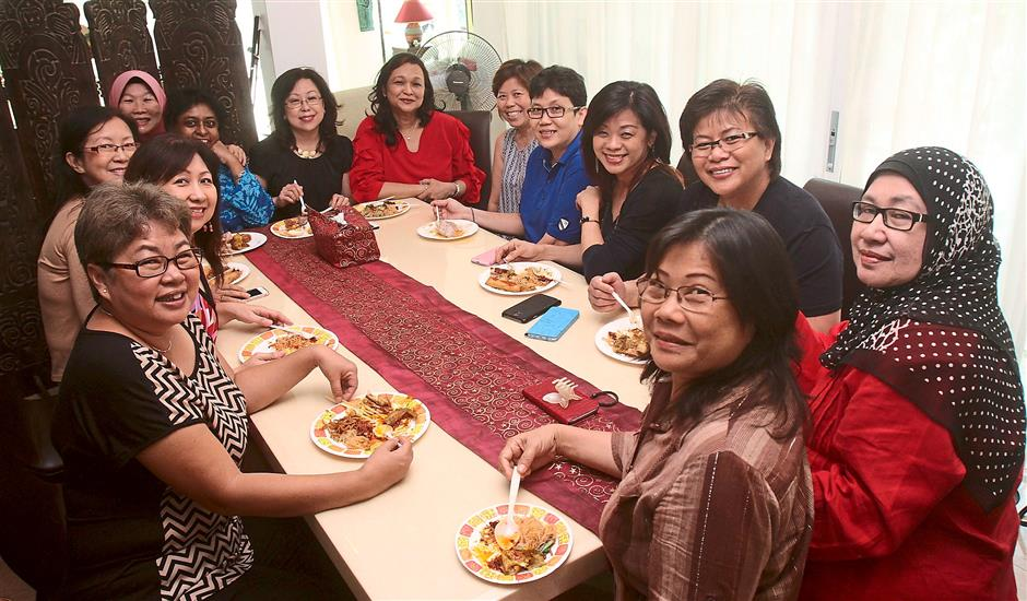 Like schoolgirls again: After they started reconnecting with each other last year, the former students of St George's Girls' School Penang have been holding regular gatherings and trips. Zahida is seated near fan (wearing red).