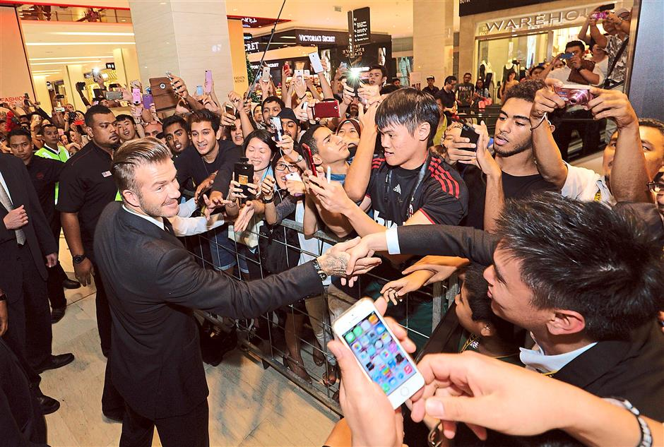David Beckham goes to Breitling bash in KL mall, crowd goes wild