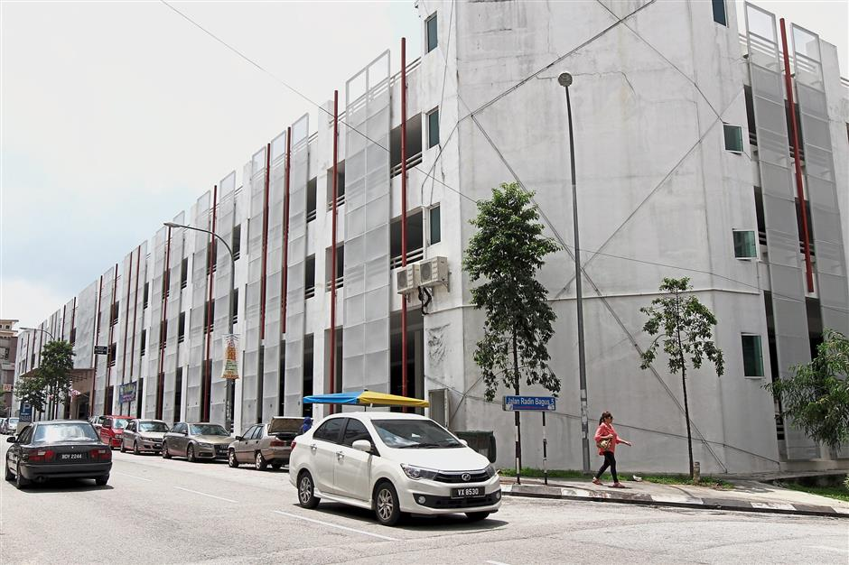 The exterior of Sri Petaling new market which doubles up as a multi-level carpark.