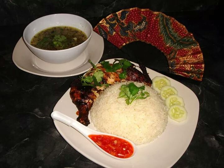 Sharmini's Kitchen serves Nasi Ayam the traditional way where the chicken is roasted and the soup has a lot of spices.