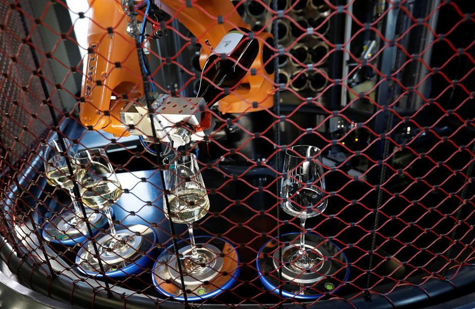 A robotic bartender prepares drinks inside a space modul-like structure before its official opening in Prague, Czech Republic, November 28, 2018. REUTERS/David W Cerny