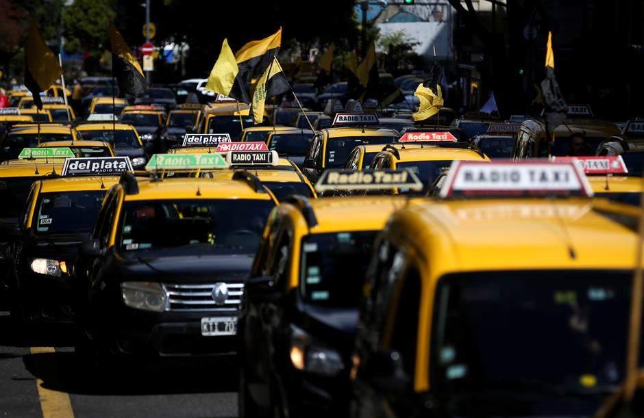 Taxis are seen during a protest against Uber Technologies, in Buenos Aires, Argentina. April 11, 2019. REUTERS/Agustin Marcarian