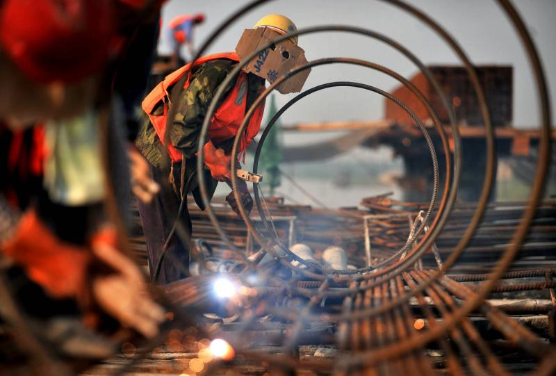 Chinese commodity imports rose strongly in 2013, with coal and iron ore climbing more than 10%, but reforms intended to move world\'s No 2 economy towards consumer-led expansion are expected to take the steam out of demand - AFP Photo.