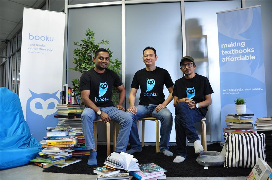 (L-R) Booku's founder and CEO Sivanathan, along with his co-founders, CTO Syed Zulazri and CIO Khairul Azizi.