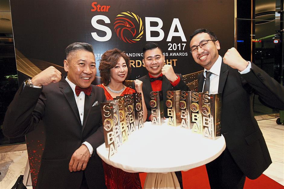 The champions: (from left) Lee, Choh, Ho and Mah celebrating their achievements.