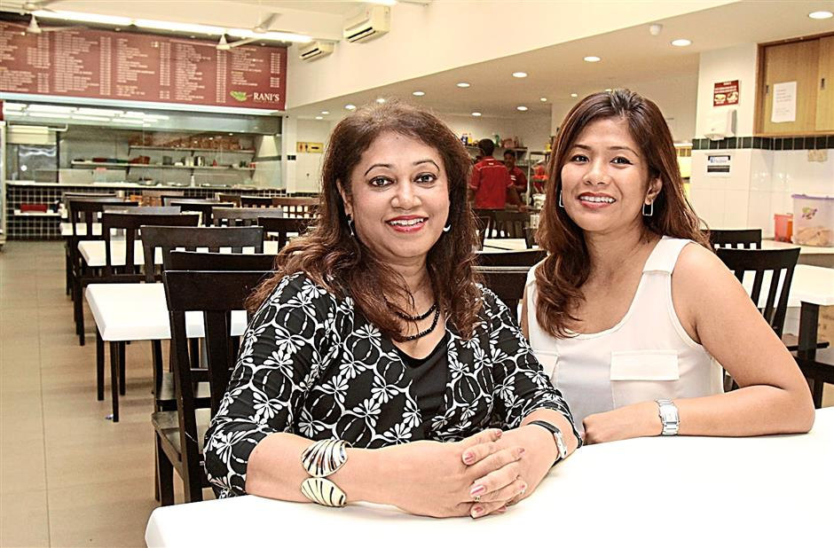 Owners of Rani¿s House of Curries, Viji Nambiar (left) and Datin Eiva Louis (right)