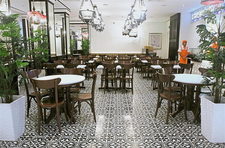The atmosphere at Encik Tan is reminiscent of an old kopitiam but has the convenience of modern dining.