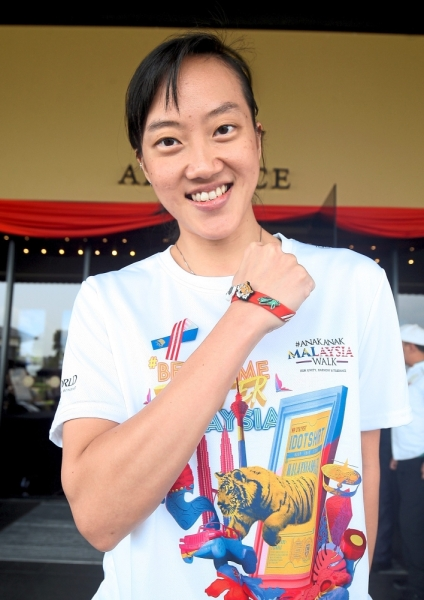 Left: National squash player Low Wee Wern is all smiles with her wristband.