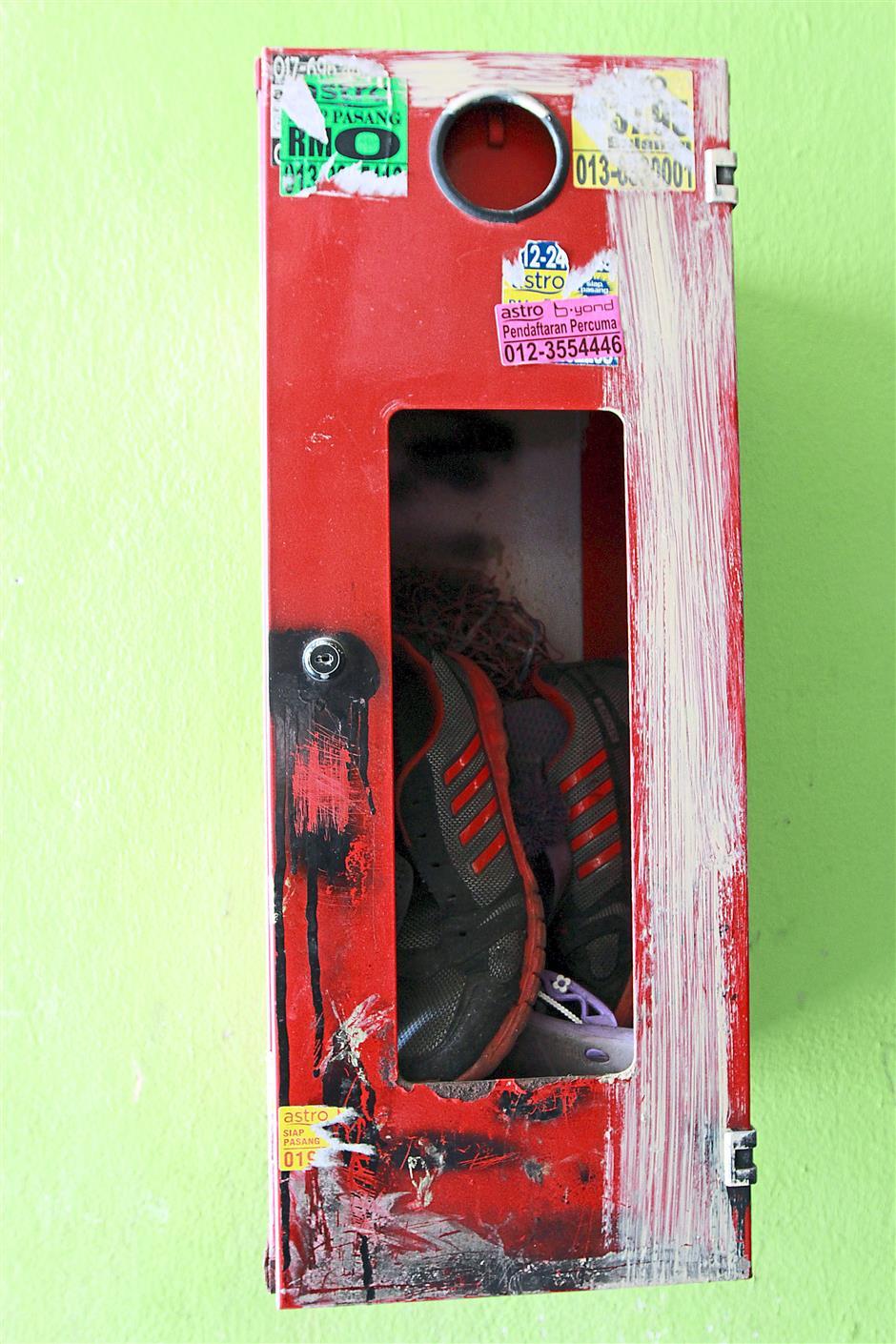 A fire extinguisher storage has become a shoe box in PPR Kota Damansara