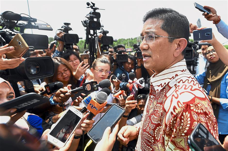 Stay or go?: Azmin speaking to the media after meeting Dr Mahathir outside the Perdana Leadership Foundation in Putrajaya. — Bernama